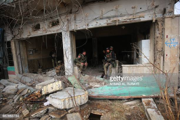 TOPSHOT Iraqi forces hold a position as they secure Mosul's AlDawasa neighbourhood on March 13 during an offensive to retake the western parts of the...