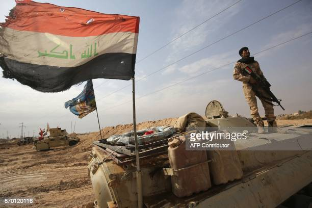 TOPSHOT Iraqi forces hold a position on November 4 2017 near the Syrian border after recapturing the border town of Qaim west of Anbar from the...