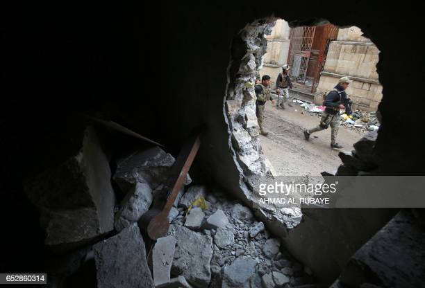 Iraqi forces inspect the damage at the destroyed museum of Mosul on March 13, 2017 after they recaptured it from Islamic State group fighters the...