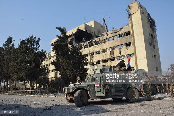 Iraqi forces members patrol a street in Mosul next to AlSalam hospital in the alWihdah neighbourhood after recapturing the area from Islamic State...