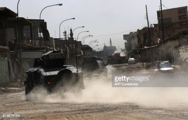 """Iraqi forces patrol a street in west Mosul on July 13 a few days after the government's announcement of the """"liberation"""" of the embattled city from..."""