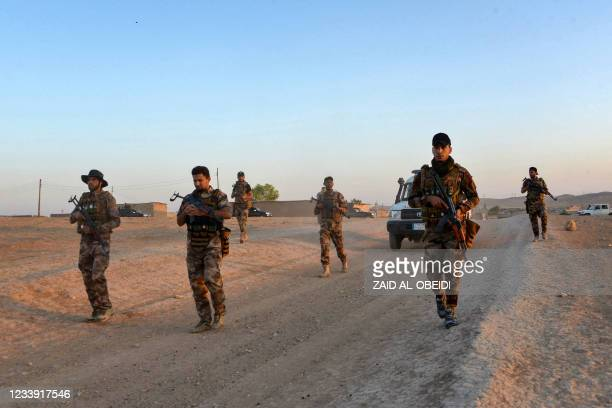Iraqi forces patrol during military operations in the south and west of the northern Iraqi city of Mosul in search of Islamic State militants, on...