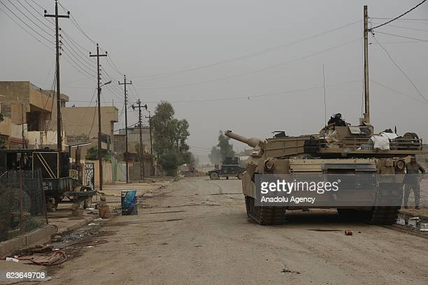 Iraqi forces patrol on the street in the Zahra neighborhood of Mosul Iraq on November 16 2016 as the operation to liberate Mosul from Daesh...