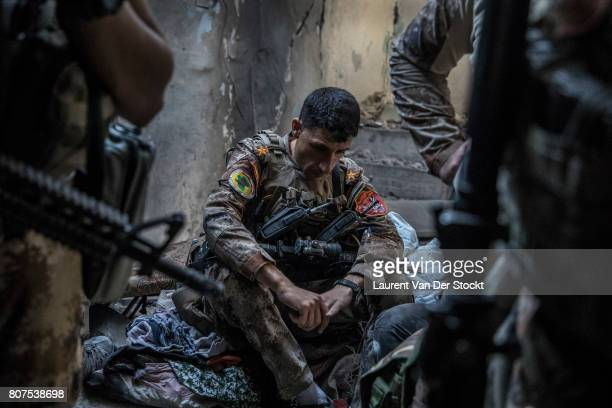 Iraqi forces rest during their operation in alNuri mosque complex in Mosul Iraq on June 29 2017 The Iraqi Army Special Operations Forces and...