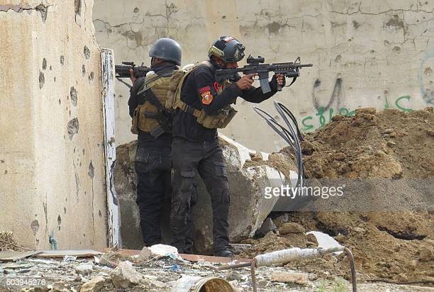 Iraqi forces secure an area near the Grand Mosque in central Ramadi, the capital of Iraq's Anbar province, on January 8 after retaking the city from...