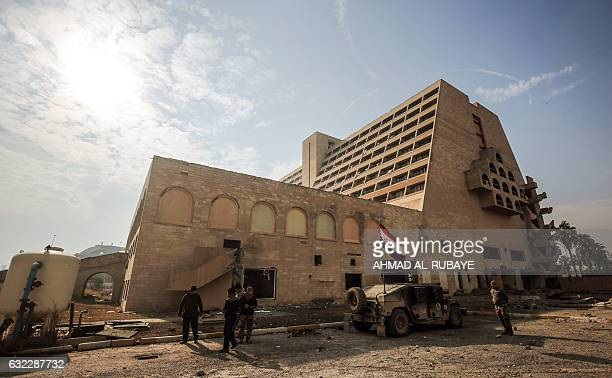 Iraqi forces stand guard outside the Oberoi hotel in the city of Mosul after government forces retook control of the area from the Islamic State...