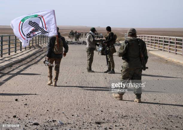 Iraqi forces, supported by members of the Hashed al-Shaabi , advance in the western desert in the northern Iraqi region of al-Hadar, 105 kilometers...
