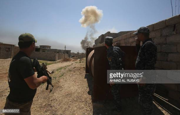 Iraqi forces take cover after a car bomb exploded in the northwestern Al-Haramat neighbourhood of Mosul on May 8 during an ongoing offensive to...
