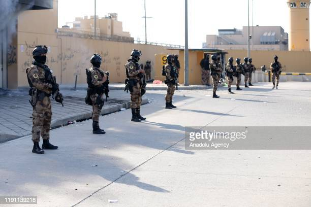 Iraqi forces take security measures as crowd leave the site after Iranian-backed Hashd al-Shaabi group urges its members to withdraw from around US...