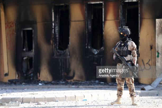 Iraqi forces take security measures as crowd leave the site after Iranianbacked Hashd alShaabi group urges its members to withdraw from around US...