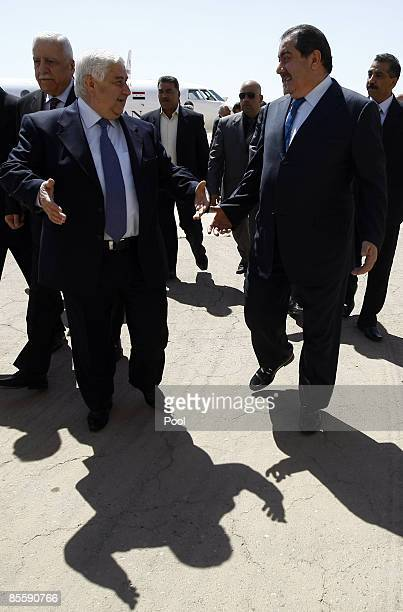 Iraqi Foreign Affairs Minister Hoshyar Zebari welcomes his Syrian counterpart Walid Muallem upon arrival at Baghdad's International Airport on March...