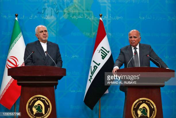 Iraqi Foreign Minister Fuad Hussein and his Iranian counterpart Mohammad Javad Zarif give a joint press conference in Iraq's capital Baghdad on April...