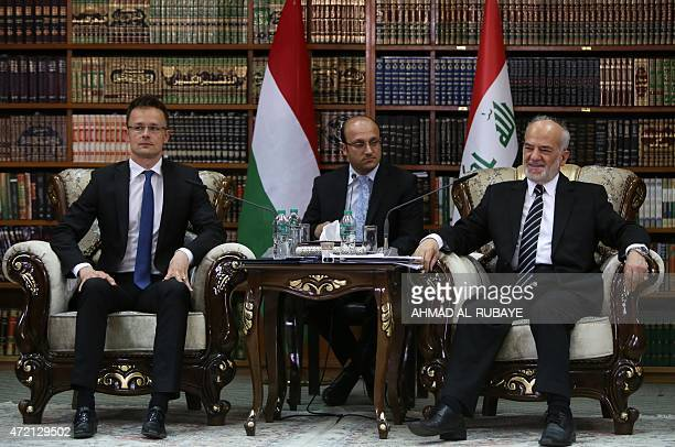 Iraqi Foreign Minister Ibrahim alJaafari meets with Hungarian Minister of External Economy and Foreign Affairs Peter Szijjarto on May 4 2015 in the...