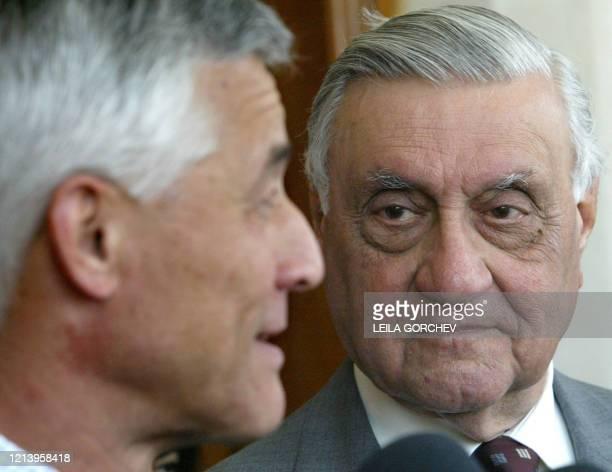 Iraqi former foreign minister Adnan Pachachi listens to Sergio Vieira de Mello UN special representative for Iraq as he talks to the press after...