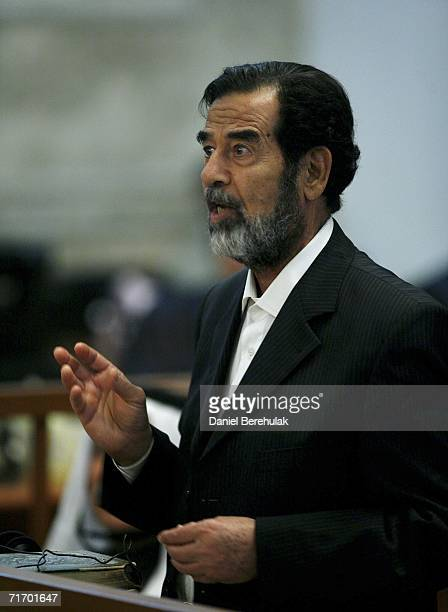 Iraqi former President Saddam Hussein addresses the court during day 3 of the Anfal campaign trial in Baghdad's heavily fortified Green Zone on...