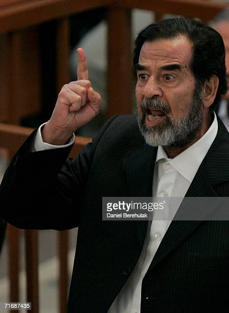 Iraqi former President Saddam Hussein addresses the court during the first day of the Anfal trial on August 21 2006 in Baghdad's heavily fortified...