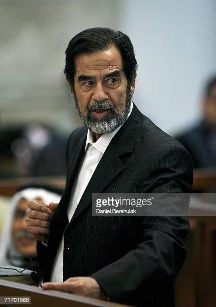 Iraqi former President Saddam Hussein looks on during day 3 of the Anfal campaign trial in Baghdad's heavily fortified Green Zone on August 23 2006...
