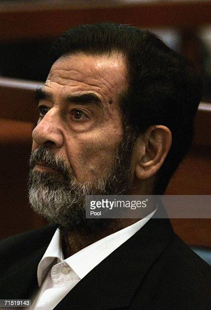 Iraqi former President Saddam Hussein looks on during final arguments of his trial in the heavily fortified Green Zone on July 26 2006 in Baghdad...
