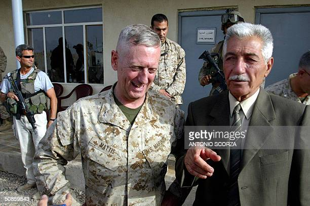 Iraqi General Mohammed Latif head of the Fallujah Brigade gestures as he stands near US Marines General James Mattis during a joint press conference...