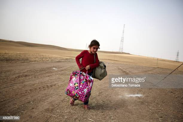 Iraqi girl fleeing from the city of Mosul arrives at a Kuridish checkpoint ISIS has captured major roads and town in central Iraq June 12 2014