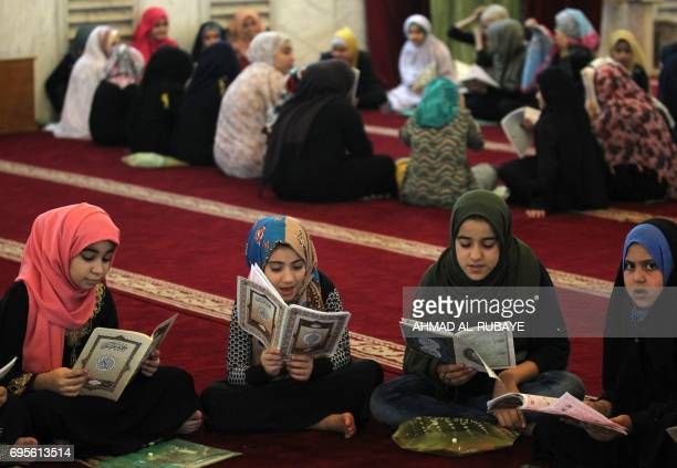 Iraqi girls attend a Koran reading class at the Sheikh Abdul Qadir aljailani mosque in central Baghdad on June 13 2016 during the Muslim holy fasting...