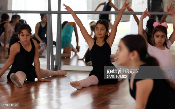 Iraqi girls take part in a ballet class at the fig club on November 25 in the northern Iraq city of Arbil the capital of the autonomous Kurdish...