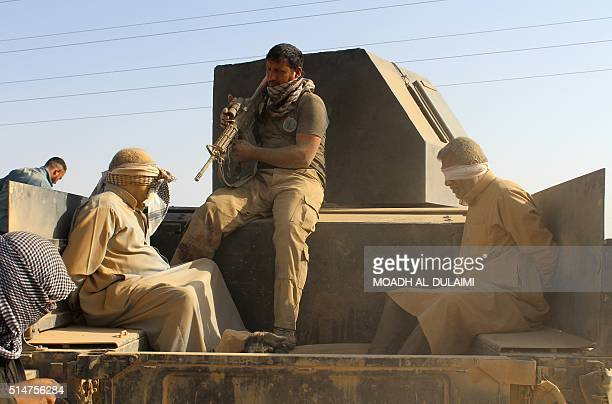 Iraqi government and counterterrorism forces arrest men suspected of belonging to the Islamic State jihadist group on March 10 2016 following an...