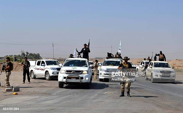 Iraqi government forces accompanied Kurdish peshmerga and Shiite militias gained control of Amirli town arrive to deliver the humanitarian supplies...