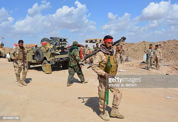 Iraqi government forces and allied militias take position in the northern part of Diyala province bordering Salaheddin province as they take part in...