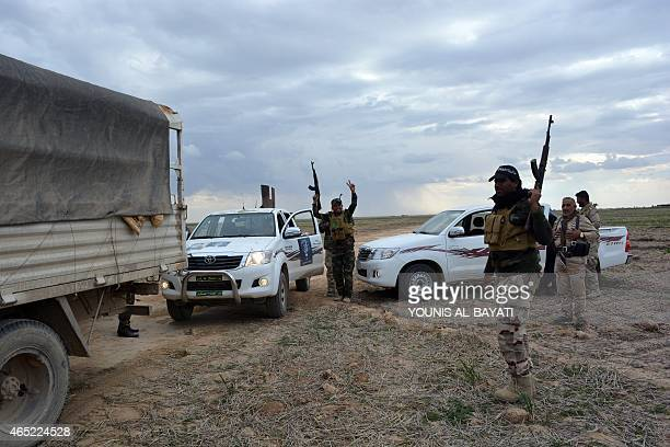 Iraqi government forces and allied militias take position in the northern part of Diyala province bordering Salaheddin province following an assault...