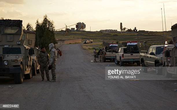 Iraqi government forces and allied militias take position on the side of a road in the northern part of Diyala province bordering Salaheddin province...