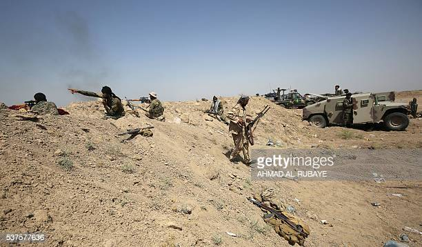 Iraqi government forces backed by fighters from the Popular Mobilisation units engage in combat in the Saqlawiyah area north west of Fallujah during...