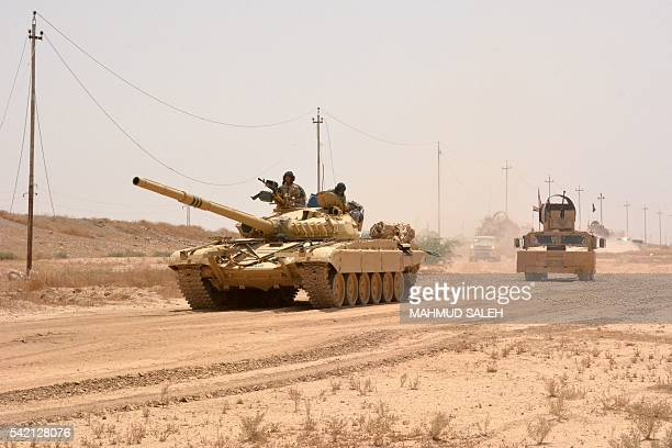 Iraqi government forces drive a tank on June 22 2016 some 40 kilometers west of Qayyarah during their operation to take the city and make it a...
