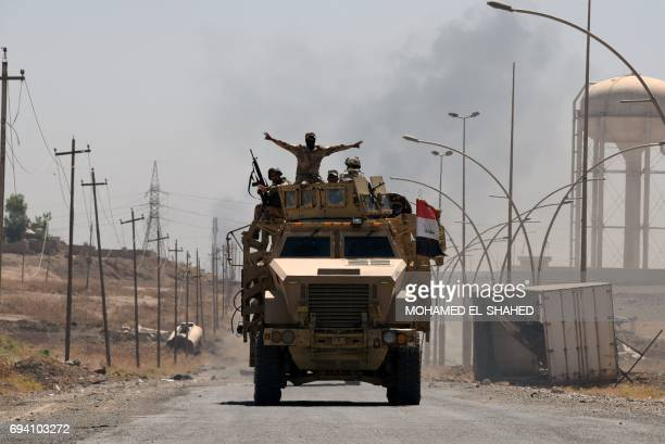 Iraqi government forces drive on a road leading to Tal Afar on June 9 during ongoing battles to retake the city from Islamic State group fighters /...