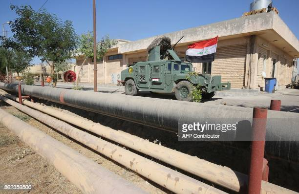 Iraqi government forces enter the Bai Hassan oil field west of the multiethnic northern Iraqi city of Kirkuk on October 17 2017 Iraqi forces took...