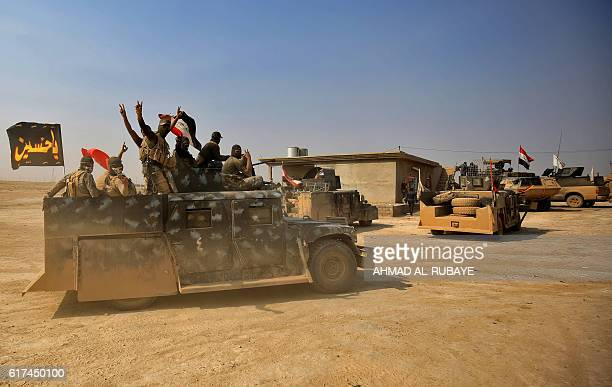 Iraqi government forces enter the village of alKhuwayn south of Mosul after recapturing the village from Islamic State group jihadists on October 23...