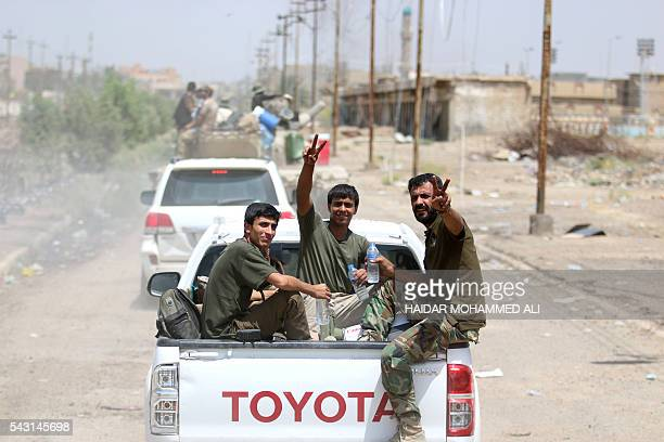 Iraqi government forces flash the V for victory sign in Fallujah 50 kilometres from the Iraqi capital Baghdad after forces retook the embattled city...