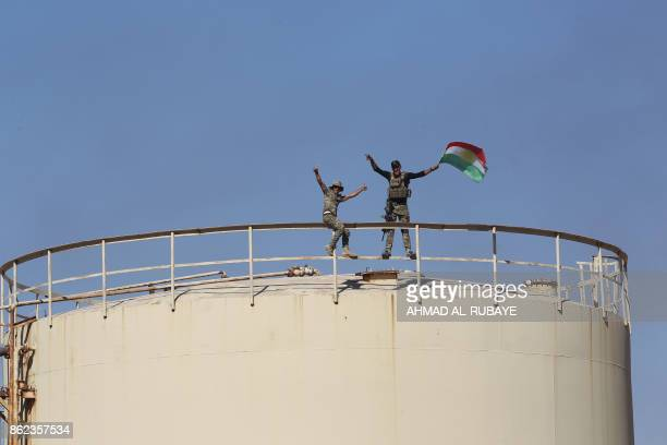 Iraqi government forces remove a Kurdish flag from the Bai Hassan oil field west of the multiethnic northern Iraqi city of Kirkuk on October 17 2017...