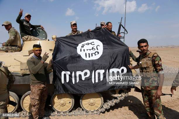 Iraqi government forces supported by fighters from the Abbas Brigade which fight under the umbrella of the Shiite popular mobilisation units hold an...