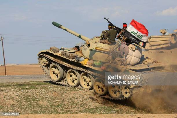 TOPSHOT Iraqi government forces supported by fighters from the Abbas Brigade which fight under the umbrella of the Shiite popular mobilisation units...