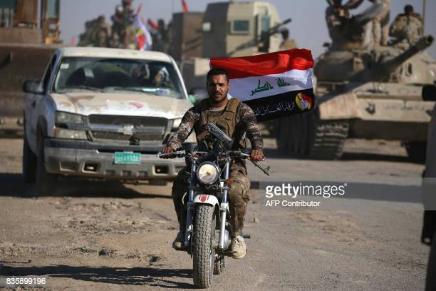 Iraqi government forces supported by fighters from the Abbas Brigade, which fights under the umbrella of the Shiite popular mobilisation units,...
