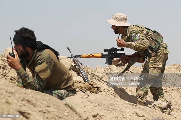 Iraqi government forces supported by the Popular Mobilisation units engage in combat in the Saqlawiyah area, north west of Fallujah, during an...