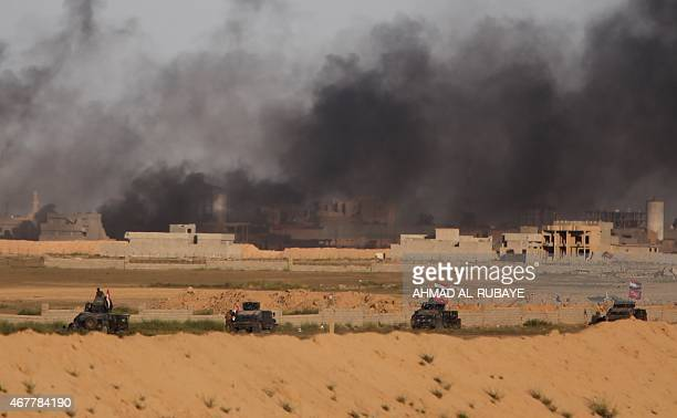 Iraqi government forces vehicles are positioned on the western outskirts of Tikrit on March 27 during a military operation to retake the city from...
