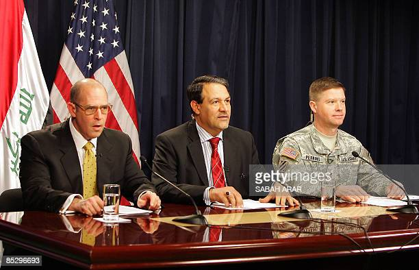 Iraqi government spokesman Ali Dabbagh holds a joint press conference with coalition forces spokesman Major General David Perkins of the US army and...