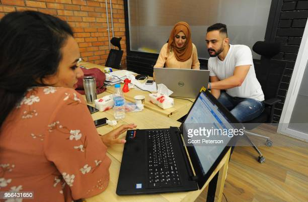 Iraqi hipsters work at the first coworking space for startup entrepreneurs called The Station in Baghdad Iraq on April 17 2018 With the defeat of the...