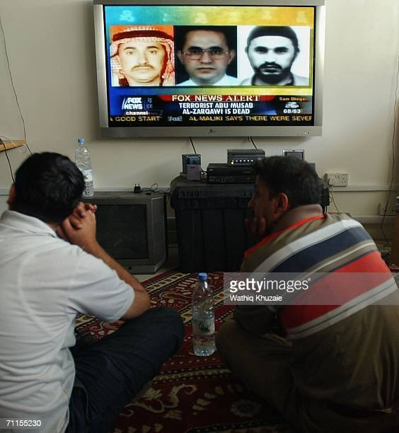Iraqi journalists watch a television showing news about the killing of the leader of alQaeda in Iraq Abu Musab alZarqawi June 8 2006 in Baghdad Iraq...
