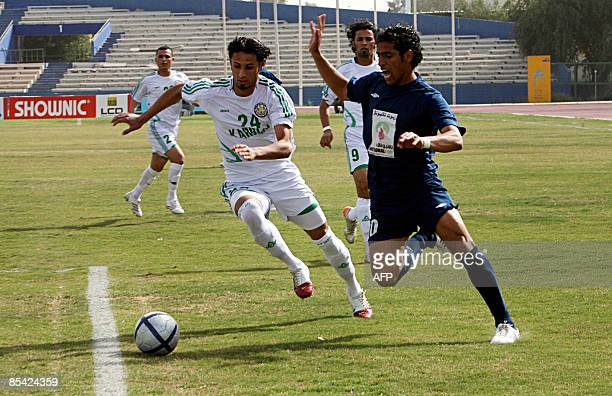 Iraqi Karbala player vies for the ball with a player from alTalaba during their football match at alShaab stadium in Baghdad on March 14 2009 AFP...