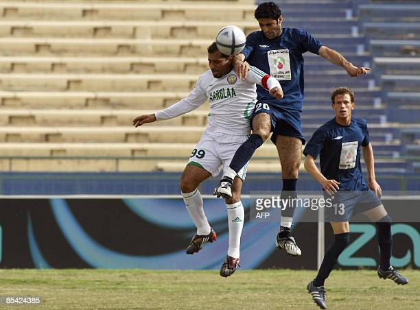 Iraqi Karbala player vies for the ball with alTalaba players during their football match at alShaab stadium in Baghdad on March 14 2009 AFP PHOTO/ALI...