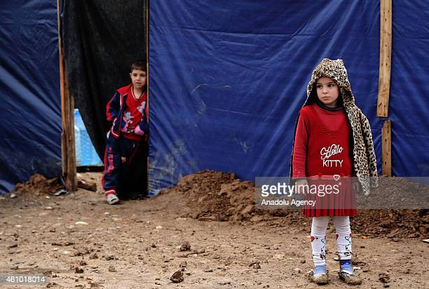 Iraqi kids fled from Islamic State of Iraq and Levant members' attacks with their family try to live under harsh conditions with summer clothes at...