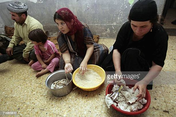 Iraqi Kurd women cook food in the fortress which was allegedly formerly used by the Iraqi Army to interrogate and torture Kurds during Saddam...